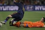 Spain's Joan Capdevila  is tackled by Robin van Persie.