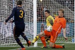 Spain's Pique watches as Netherlands' Kuyt and Stekelenburg block a shot on goal during World Cup final soccer match at Soccer City stadium in Johannesburg